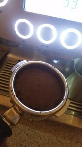 The portafilter after automatic grinding, dosing and tamping.