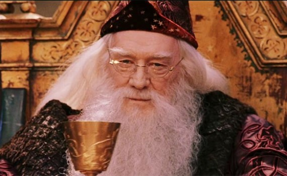 Dumbledore from Harry Potter. I reckon there's coffee in that cup.