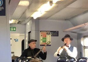 Musicians on a train.