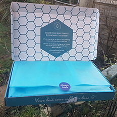 A photo of the Blue coffee box, coffee subscription box.
