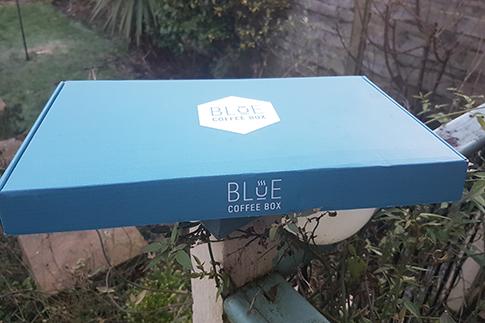 Blue coffee box, coffee box subscription service.