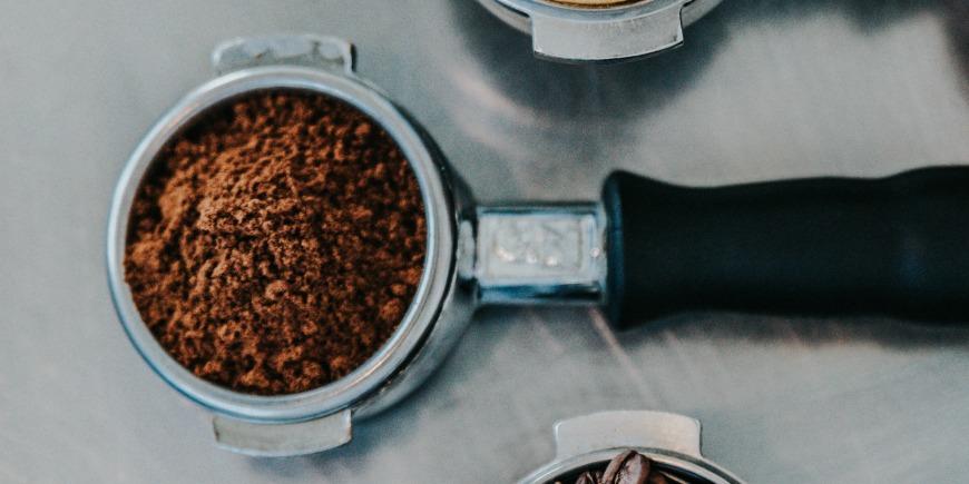 Ground coffee in portafilter.